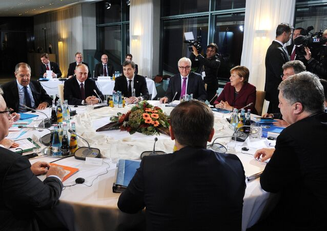 Russian President Vladimir Putin, German Chancellor Angela Merkel, background 2nd right, and Ukrainian President Petro Poroshenko, foreground right, during the Normandy format meeting between the leaders of Germany, Russia, Ukraine and France on settling the Ukrainian conflict, at the Paul Loebe Haus parliamentary building in Berlin. (File)