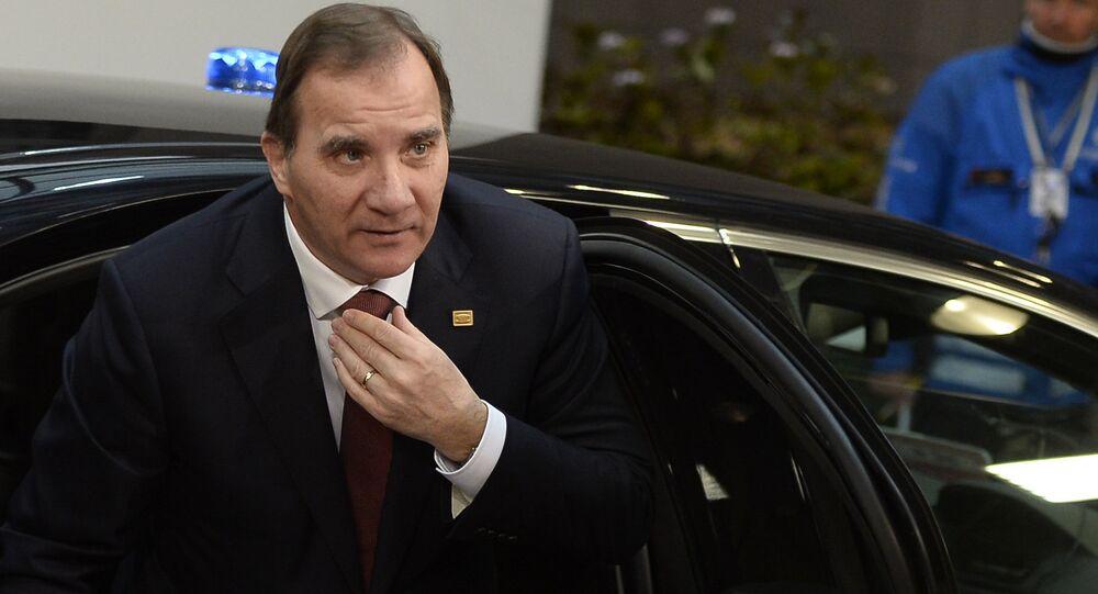 Sweden's Prime Minister Stefan Lofven steps out of a car