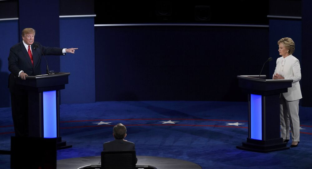 Republican US presidential nominee Donald Trump speaks as Democratic US presidential nominee Hillary Clinton listens during their third and final 2016 presidential campaign debate