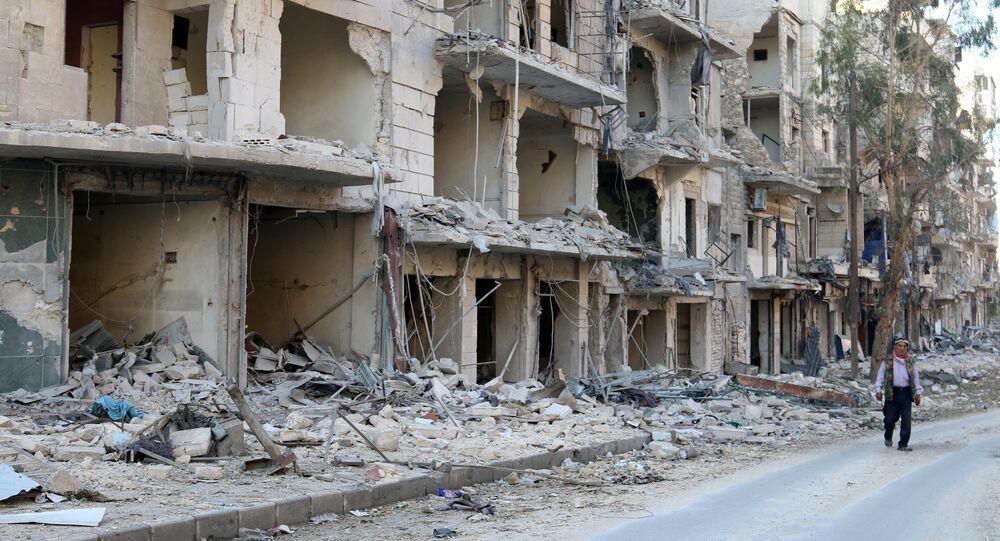 A man walks past damaged buildings in the rebel held besieged al-Sukkari neighbourhood of Aleppo, Syria October 19, 2016.