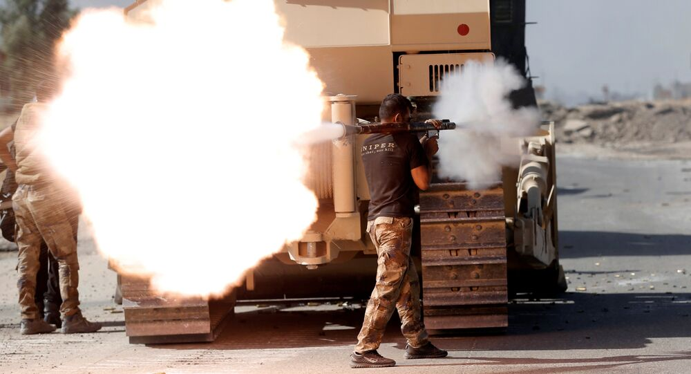 An Iraqi special forces soldier fires an RPG during clashes with Islamic States fighters in Bartella, east of Mosul, Iraq October 20, 2016.