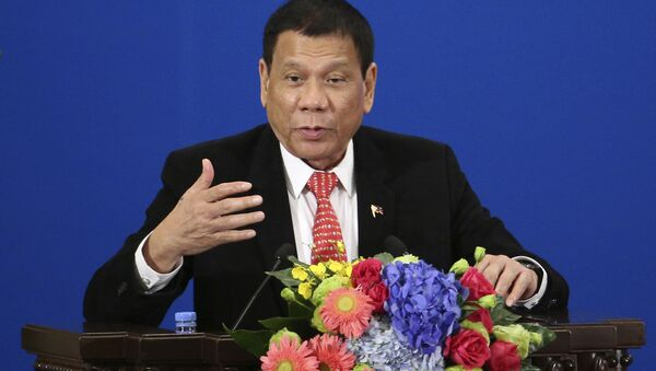Philippine President Rodrigo Duterte delivers a speech during the Philippines-China Trade and Investment Forum at the Great Hall of the People in Beijing - Sputnik International