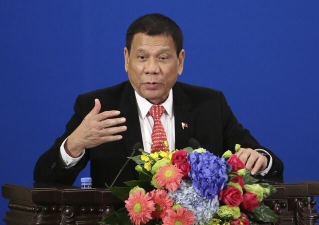 Philippine President Rodrigo Duterte delivers a speech during the Philippines-China Trade and Investment Forum at the Great Hall of the People in Beijing