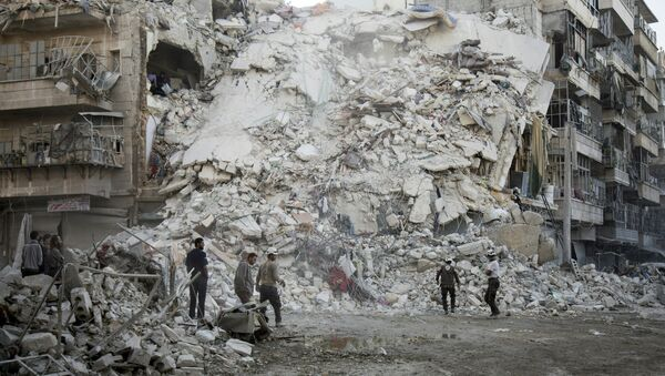 Members of the Syrian Civil Defence, known as the White Helmets, search for victims amid the rubble of a destroyed building following reported air strikes in the rebel-held Qatarji neighbourhood of the northern city of Aleppo, on October 17, 2016 - Sputnik International