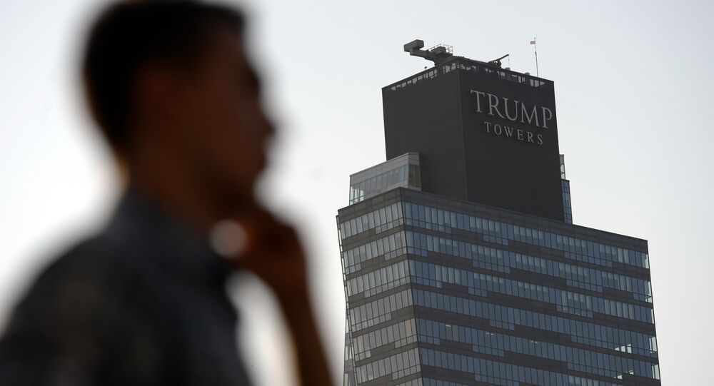 A man walks past the Trump Towers building in Istanbul on July 30, 2015