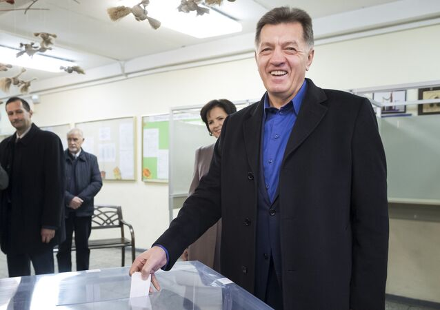 Lithuania's Social Democrat party leader and Prime Minister Algirdas Butkevicius votes at a polling station during parliamentary elections in Vilnius, Lithuania, Sunday, Oct. 23, 2016