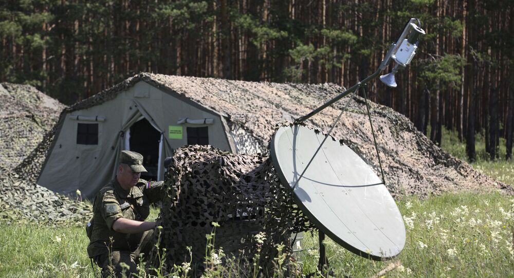 Servicemen adjust communications with units' headquarters in the assembly area of combined forces of the Central Military District and airborne troops at the Chebarkul firing range as part of a sudden operational readiness test