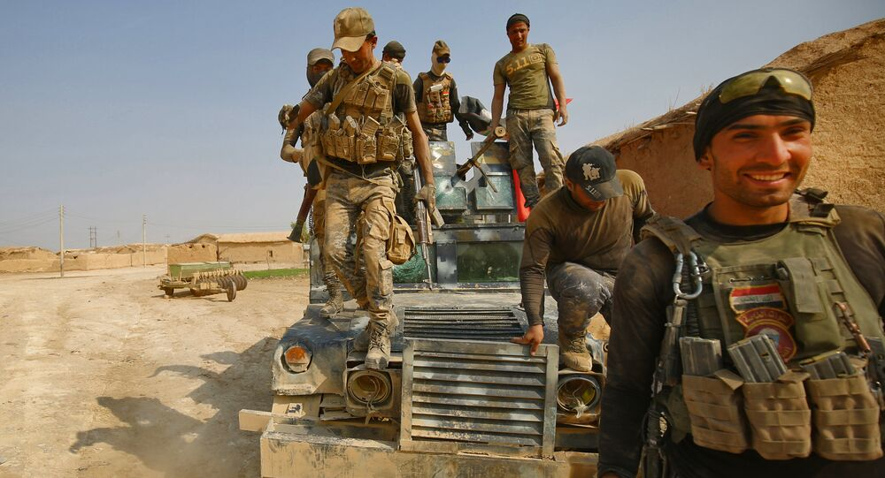 Iraqi forces enter the village of al-Khuwayn, south of Mosul, after recapturing the village from Islamic State (IS) group jihadists on October 23, 2016