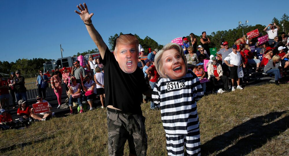 Craig Wendel dresses as Republican U.S. presidential nominee Donald Trump and his wife Jill Wendel wears a Hillary Clinton mask as they support Trump at a campaign rally in Naples, Florida, U.S. October 23, 2016