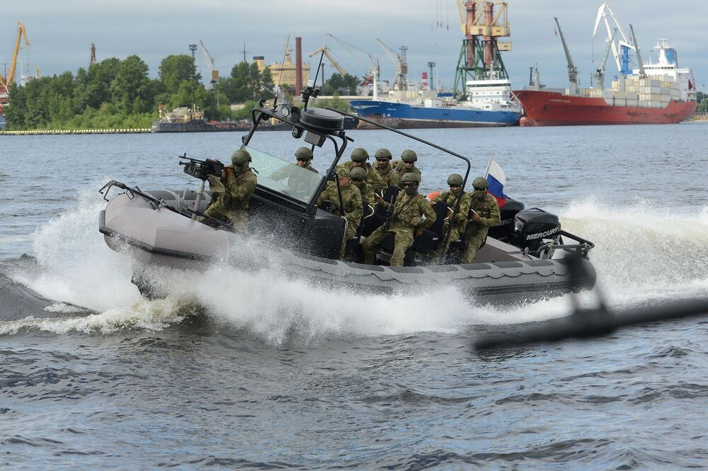 Soldiers on a military boat during the opening ceremony of the 7th International Maritime Defense Show in St. Petersburg.