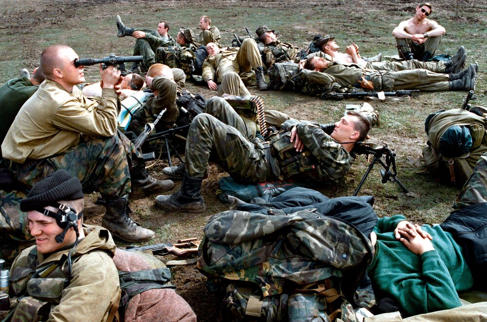 Paratroopers of the reconnaissance platoon in Chechnya rest after combat operations.