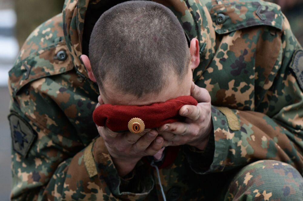 A soldier of the Special Purpose unit of the Federal National Guard Troops Service is seen during a ceremony, held after trials for the right to wear the maroon and dark green berets at the training center Gorny in the Novosibirsk region. Maroon and dark green berets are worn by members of elite Ministry of Internal Affairs Spetsnaz units.