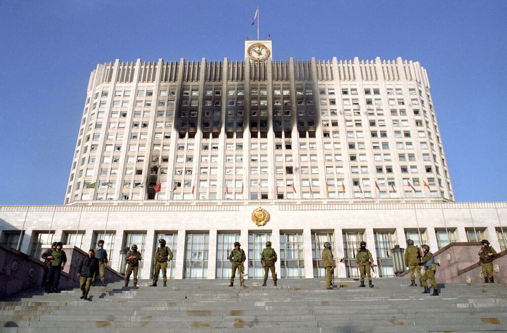 Soldiers of the Alpha special troop control the entrance to the Supreme Council building in October 1993. Alpha was one of the Soviet and Russian special forces units of the Ministry of Internal Affairs.