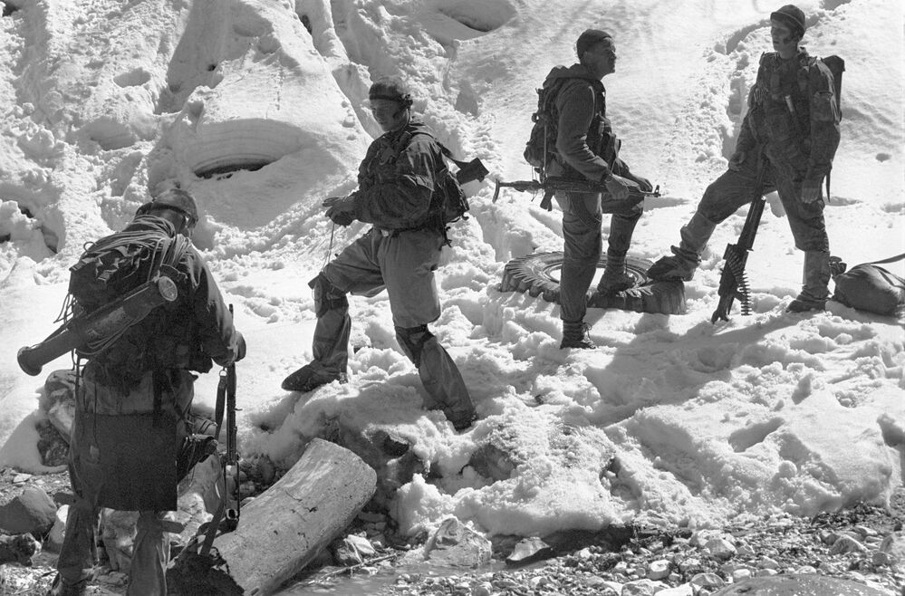 Soldiers of the special reconnaissance platoon of the 45th regiment of the Russian Airborne Forces during an operation to identify and destroy Chechen militant camps in a mountain gorge at the Bass River in the Vedensky District of Chechnya.
