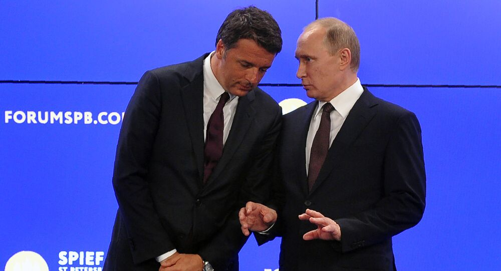 Russian President Vladimir Putin (R) talks to Italy's Prime Minister Matteo Renzi as they attend a signing ceremony following their talks at the St. Petersburg International Economic Forum in Saint Petersburg on June 17, 2016