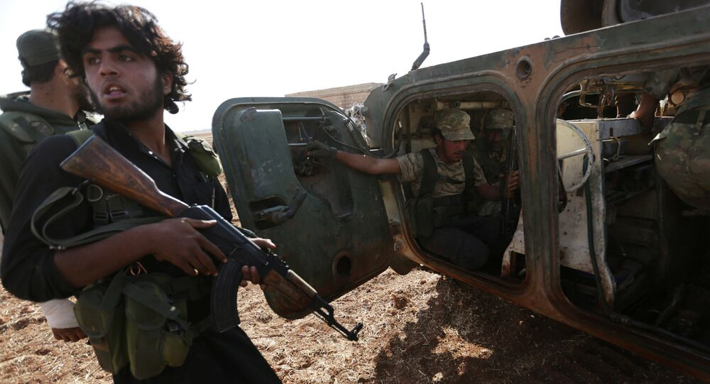 Rebel fighters ride a military vehicle on the outskirts of Syria Democratic Forces (SDF) controlled territory.