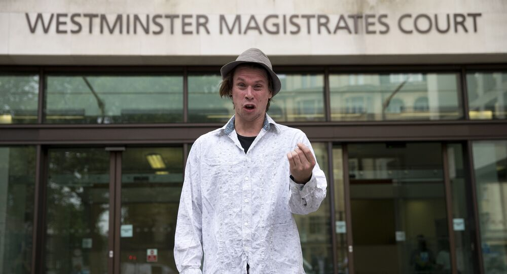 Lauri Love poses for photographers as he arrives at Westminster Magistrates Court in central London on July 25, 2016.
