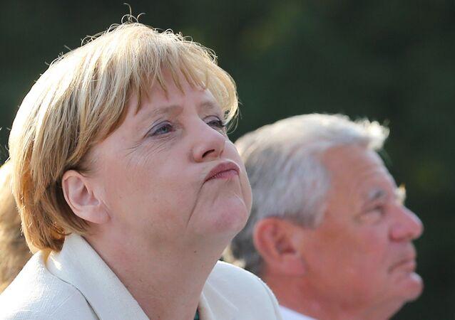 German Chancellor Angela Merkel (L) and German President Joachim Gauck attend an event for citizens at Bellevue Palace in Berlin on September 9, 2016.