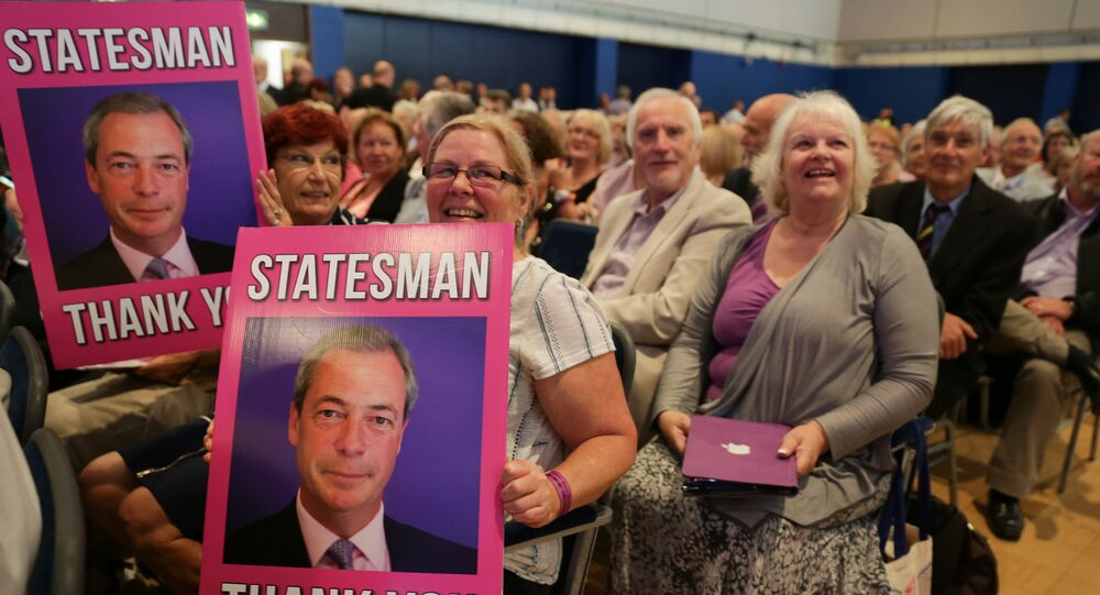 UKIP supporters hold placards of outgoing anti-EU UK Independence Party (UKIP) leader Nigel Farage at the UKIP Autumn Conference in Bournemouth, on the southern coast of England, on September 16, 2016.