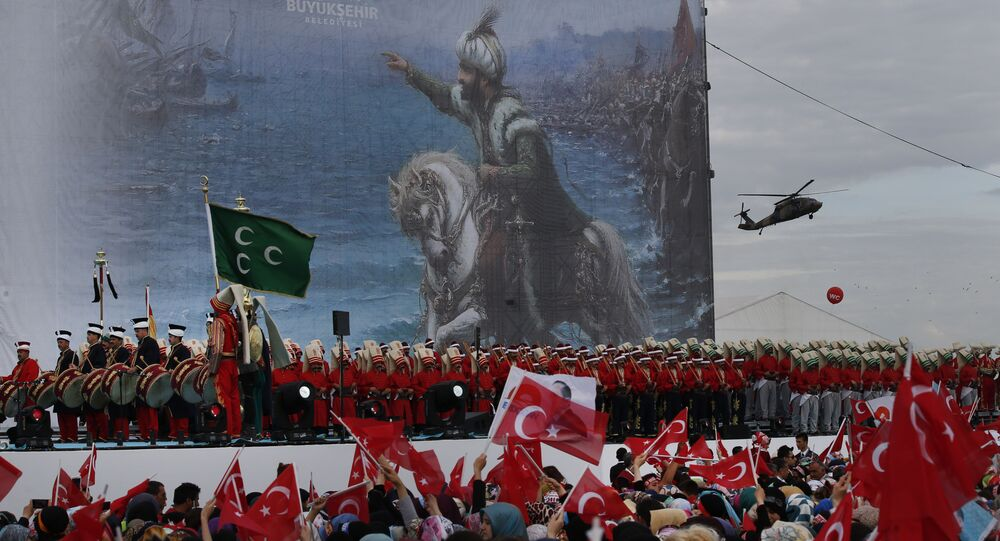 Turkish soldiers, musicians and performers wearing Ottoman-era uniforms perform in Istanbul, Turkey, Saturday, May 30, 2015 during a rally to commemorate the anniversary of city's conquest by the Ottoman Turks