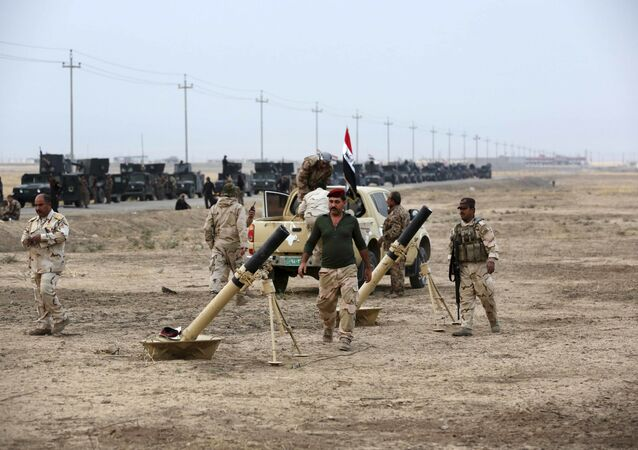 Iraqi special forces prepare to attack Daesh positions as fighting to retake the extremist-held city of Mosul enters its second week, in the village of Tob Zawa, outside Mosul, Monday, Oct. 24, 2016