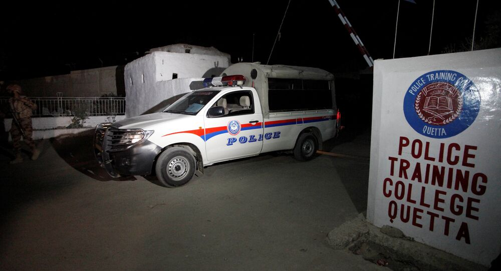 A police truck is seen at a gate to the Police Training Center after an attack on the center in Quetta, Pakistan October 25, 2016