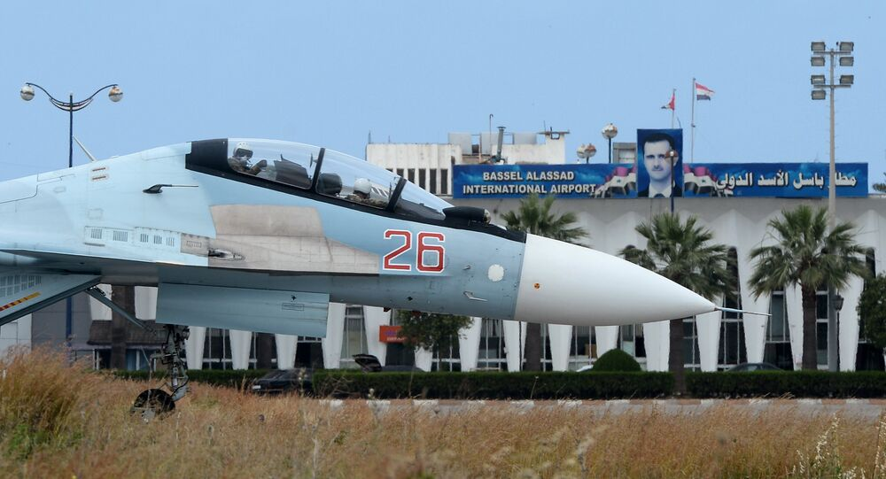 A Russian Su-30 aircaft on a runway at the Hmeimim airbase in Syria
