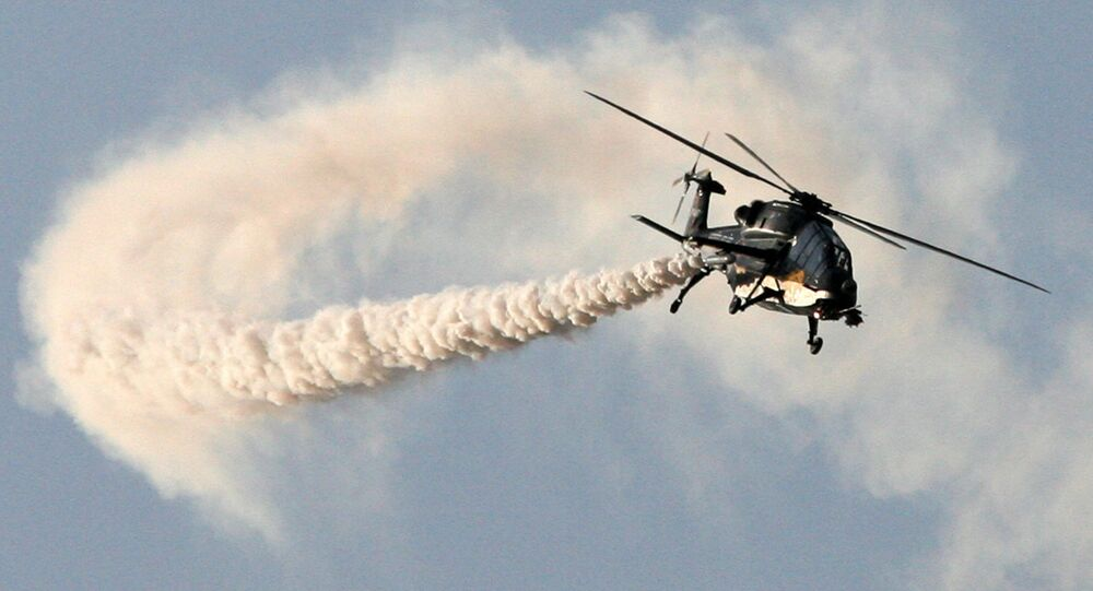 This handout photograph released by the Ministry of Defence on February 20, 2013, shows a HAL Black Tiger Light Combat Helicopter (LCH) performing a flypast during a full dress rehearsal for the Indian Air Force's Iron Fist 2013 military exercicse in Pokhran, near Jaisalmer in India's Rajasthan state, on February 19, 2013