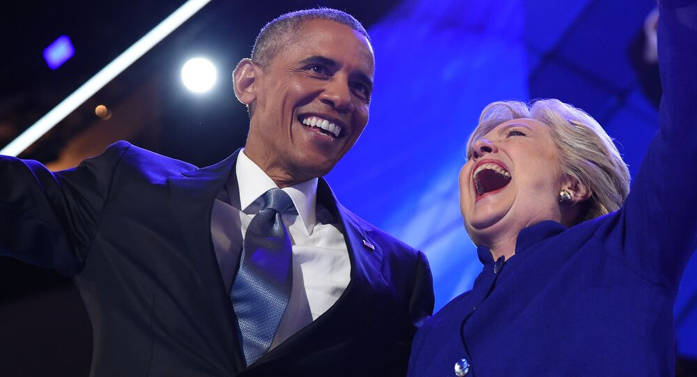 US President Barack Obama (L) hugs US Presidential nominee Hillary Clinton during the third night of the Democratic National Convention at the Wells Fargo Center in Philadelphia, Pennsylvania, July 27, 2016