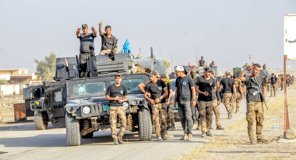 Yazidi fighters taking part in the Iraqi army's operation to liberate Mosul