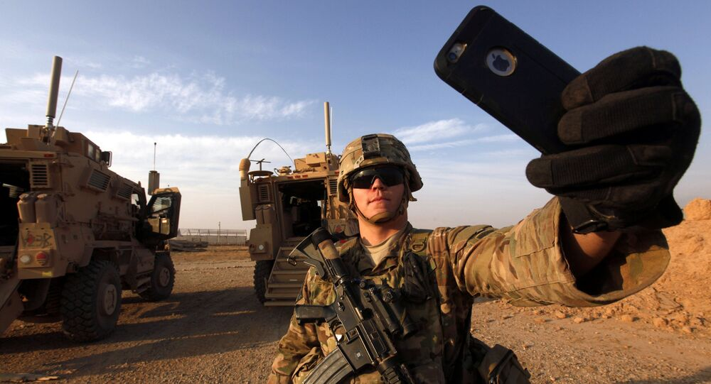 An American soldier takes a selfie at the US army base in Qayyara, south of Mosul October 25, 2016