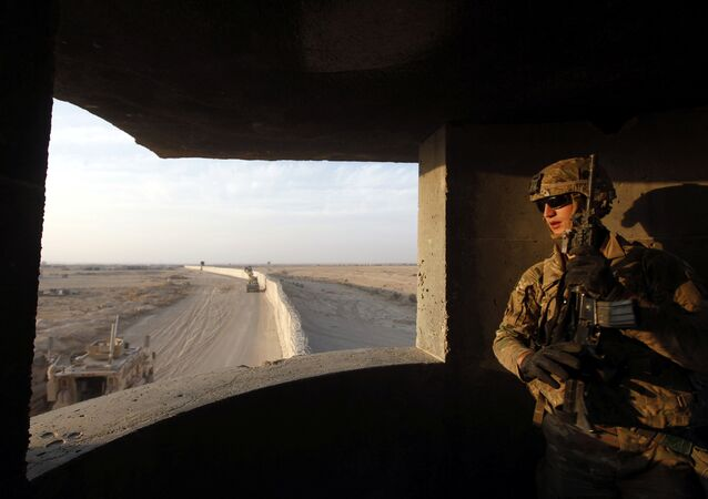 An American soldier takes his position at the U.S. army base in Qayyara, south of Mosul October 25, 2016