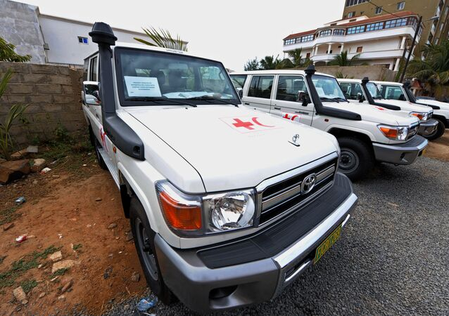 A picture shows vehicles offered to the International Federation of Red Cross and Red Crescent Societies (IFRC) in Senegal by the government of Botswana to help the country fight against Ebola in Dakar on December 2, 2014