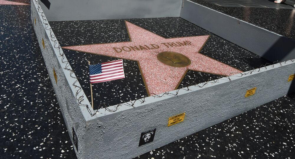 The Hollywood Walk of Fame Star of Republican presidential candidate Donald Trump is surrounded by a miniture barbed-wire wall placed there by Californian street artist Plastic Jesus in Hollywood, California on July 20, 2016