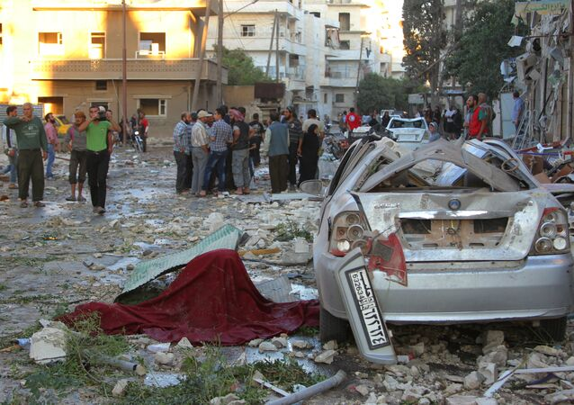People inspect the damage at a site hit by airstrikes in Idlib, Syria September 29, 2016