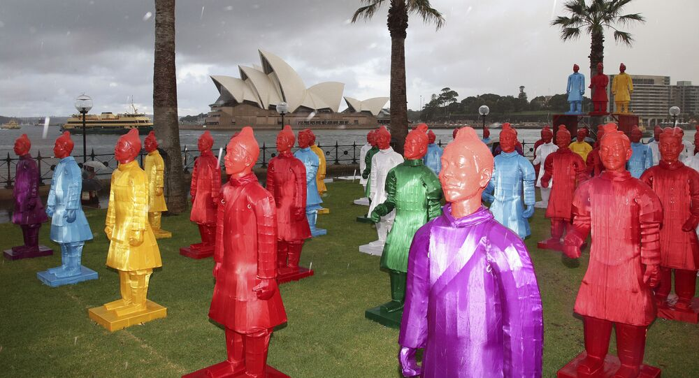 With a backdrop of the Sydney Opera House, The Lanterns of the Terracotta Warriors stand on display in rain during the launch of the Chinese Festival in Sydney, Australia, Friday, Feb. 13, 2015