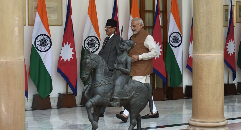 Indian Prime Minister Narendra Modi (R) walks with Nepalese Prime Minister Pushpa Kamal Dahal prior to a meeting in New Delhi on September 16, 2016