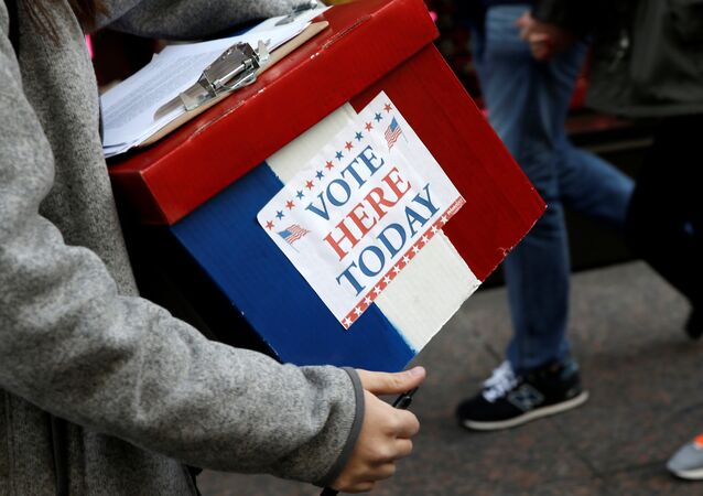 An election volunteer holds a box outside Trump Tower in the Manhattan borough of New York City, October 26, 2016
