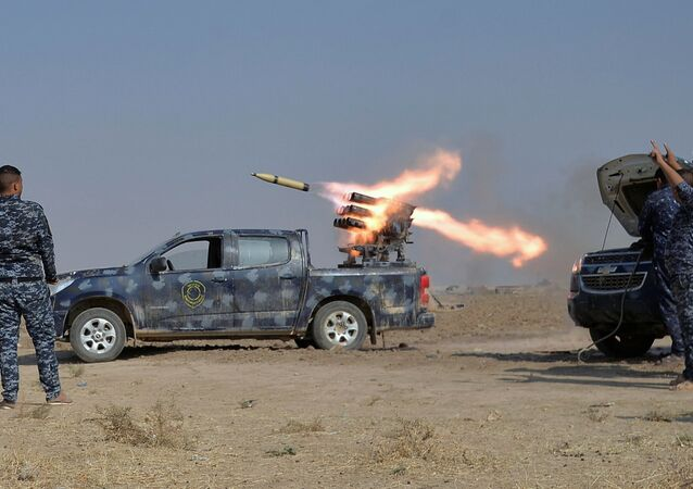 Federal police forces launch a rocket during clashes with Islamic State militants in south of Mosul