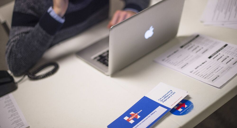 A volunteer makes phone calls from his desk at the Hillary for Iowa Campaign Headquarters in Des Moines, Iowa, January 22, 2016, ahead of the Iowa Caucus.
