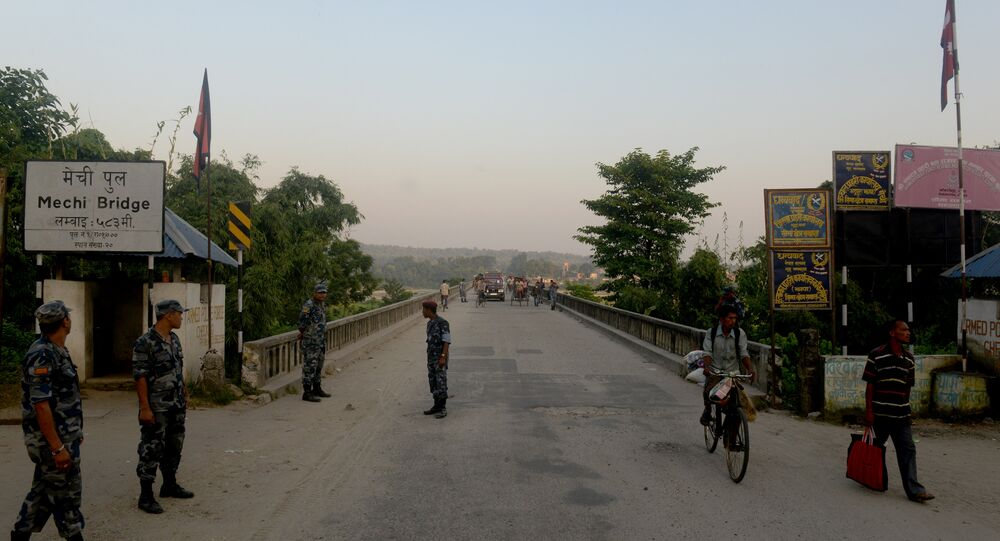 Nepalese security personnel stand guard at an entry point to Nepal from India at Mechinagar on the eastern Nepalese border with India. (File)