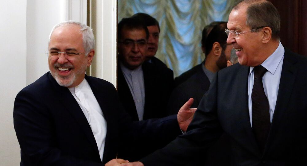 Russian Foreign Minister Sergei Lavrov (R) shakes hands with his Iranian counterpart Mohammad Javad Zarif during a meeting in Moscow, Russia, October 28, 2016