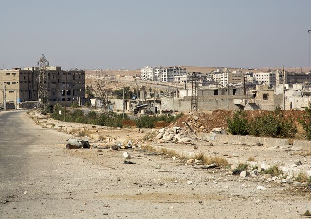 A general view shows a damaged road and abandoned buildings in Aleppo's militant-held Kalasa neighbourhood