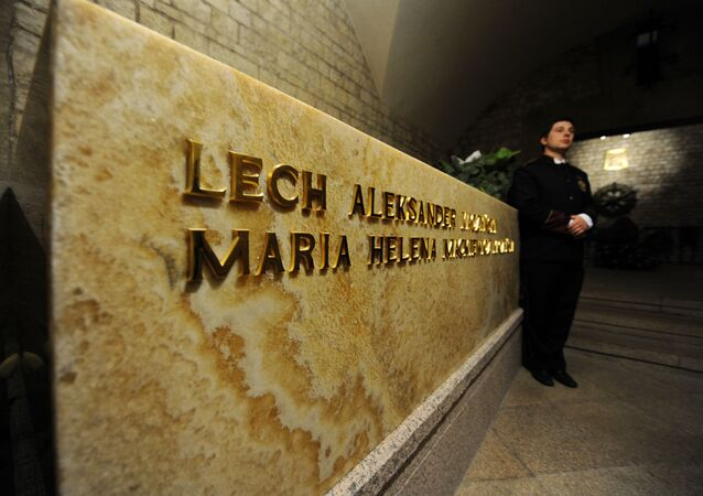 A Wawel Castle employee stands by the tomb of late Polish President Lech Kaczynski and his wife Maria after their burial in the crypt of Wawel Castle's Cathedral. (File)