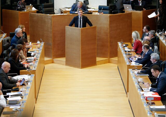 Members of the Wallon parliament listen as Walloon Minister-President Paul Magnette (C) speaks at a plenary session during a debate on the CETA (EU-Canada Comprehensive Economic and Trade Agreement) in Namur