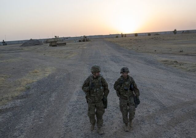US soldiers walking at the Qayyarah military base during the ongoing operation to recapture the last major Iraqi city under the control of the Islamic State (IS) group jihadists. (File)
