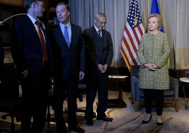 Clinton advisers Jake Sullivan (L), Nick Burns (2L) and John Podesta (2R) wait with Clinton Campaign Chairman, Democratic presidential nominee Hillary Clinton for a meeting with Ukrainian President Petro Poroshenko on September 19, 2016 in New York.