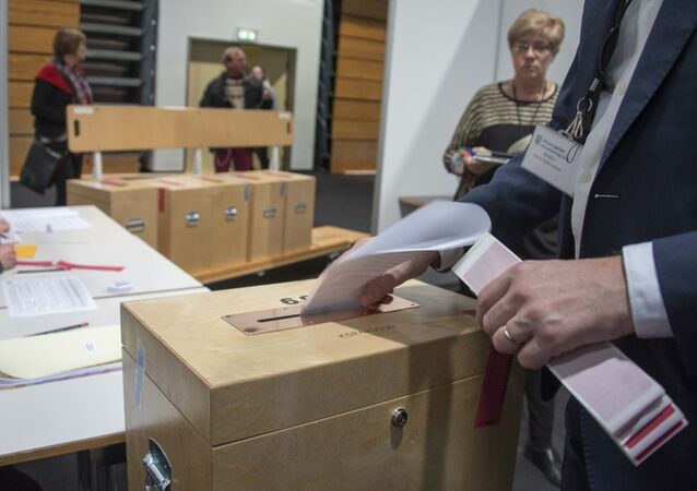 A member of the polling commission prepares the ballots for counting at a polling station in Kopavogur on October 29, 2016.