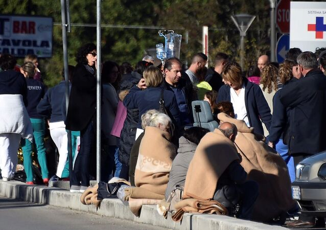People evacuated from an hospital are covered with blankets following a quake in Rieti, Italy, October 30, 2016.