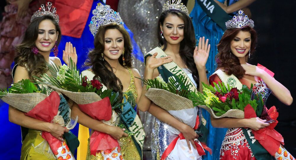 Miss Ecuador Katherine Espin (2nd L), crowned this year's Miss Earth, Miss Colombia Michelle Gomez (2nd R), won as Miss Earth Air, Miss Brazil Bruna Zanardo (L), as Miss Earth Fire and Miss Venezuela Stephanie De Zorzi, won as Miss Earth Water, wave to photographers during the Miss Earth 2016 International coronation night at a mall in Pasay city, metro Manila, Philippines